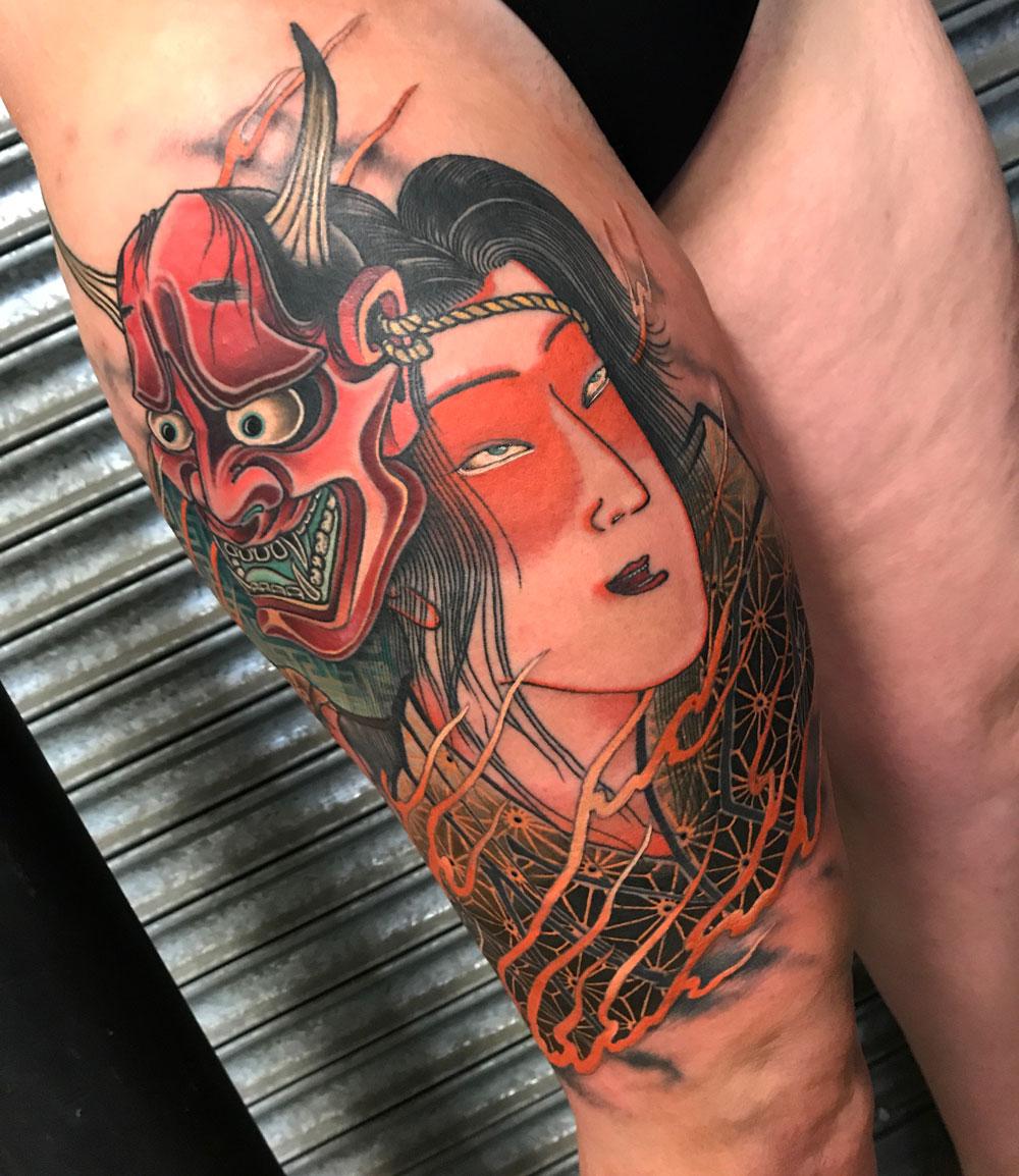 ryan-ussher-mask-leg-tattoo