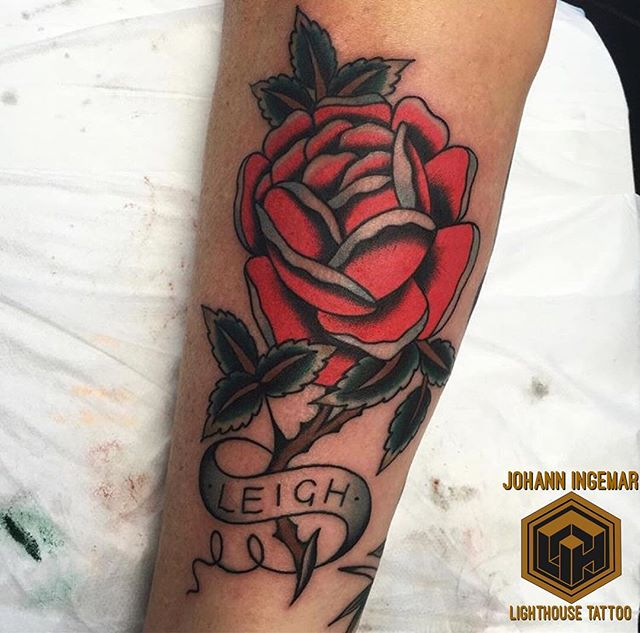Classic bright red rose with a dedication by @sign_of_the_wolf FOR BOOKINGS w: lighthousetattoo.com.au : contact@lighthousetattoo.com.au ️: (+61 2) 9316 4565
